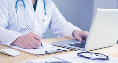 remote patient monitoring by doctor at laptop