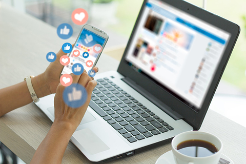 woman on laptop using social media