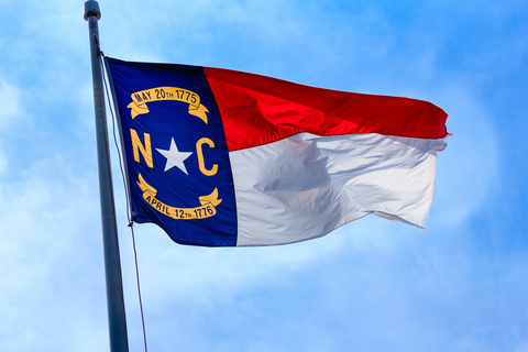 North Carolina State Flag flying in the wind at Fort Macon.