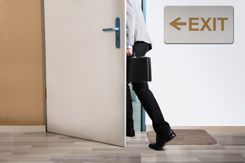 Businessperson walking out