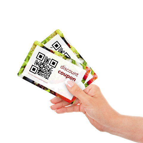 Hand holding two coupons