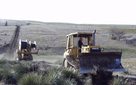 Plowing fiber optic cable in Northwest Kansas (Image: Rural Telephone via USDA Flickr stream)