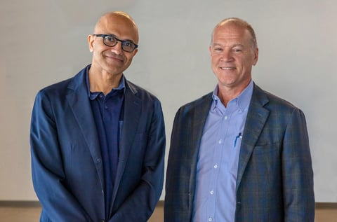 Microsoft CEO Satya Nadella left poses with AT&T Communications CEO John Donovan