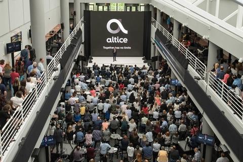 Altice USA logo amid crowd