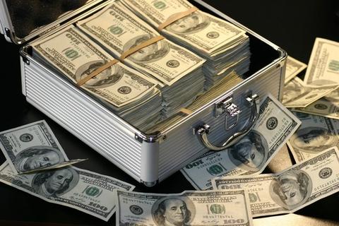Money piles cash