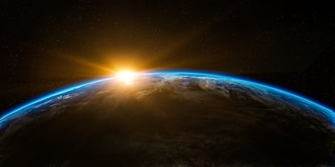Illustration of sunrise over planet earth in space