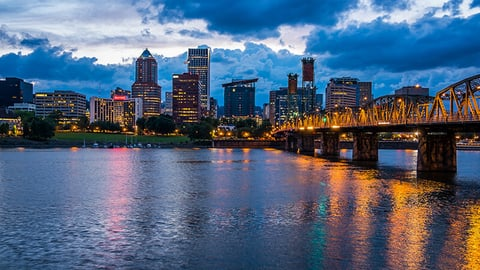 View of the Portland, Oregon skyline across the river at night time