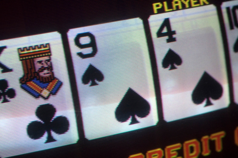 Closeup of video poker machine screen