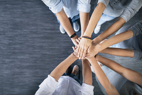 Stack of hands. Unity and teamwork concept