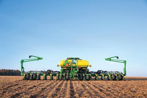 John Deere tractor and row planter