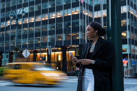 Woman on smartphone in city
