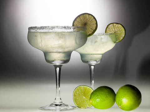 glasses with alcohol and limes