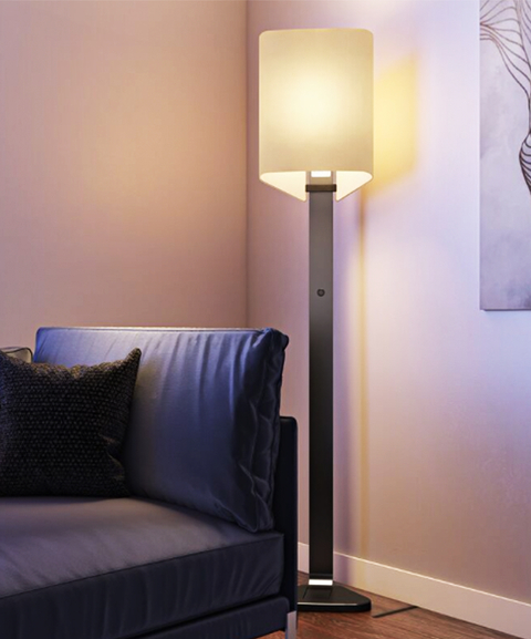 The lamp has smooth lines and a fine linen shade.