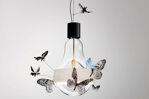 Designer Ingo Maurer launched the limited-edition Flatterby, a hanging lamp with 10 handmade butterflies flitting around the bulb.