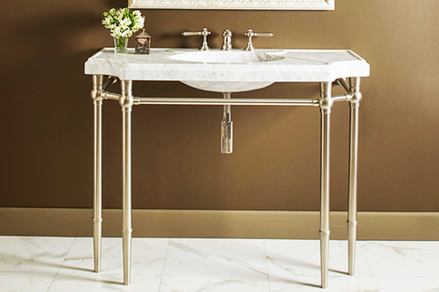 The Bayonne console sink was sculpted and beveled from a single block of Italian Carrara Marble and rests on finely crafted tapered legs that recall a classic design.