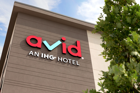 The Avid Hotels logo on the side of the Avid Hotel Oklahoma City – Quail Springs