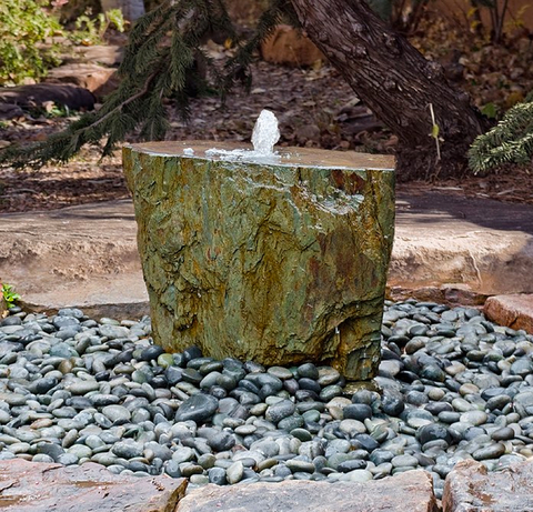True to its name, the French slate fountain is carved from large pieces of fine-grained metamorphic rock imported from Maël-Carhaix, Côtes-d'Armor, Brittany in northwestern France.