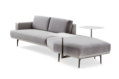 The Lyda sofa, designed by Lauren Rottet, is upholstered in a warm neutral mohair and gray leather, and complemented by steel arms and a marble tablet surface.