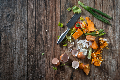 food scraps on a table with a knife