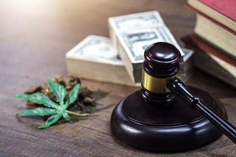 A gavel and cannabis leaf