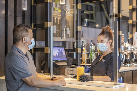 man at a bar with a mask at Hyatt Regency Jacksonville