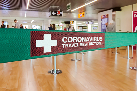 Coronavirus travel restrictions sign at airport