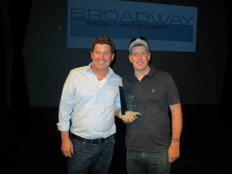 In Concerts Craig Mitchell L of LMG Touring and lighting designer Brock Hogan R accept the award for the Train Mermaids of Alcatraz tour submitted by LMG Touring