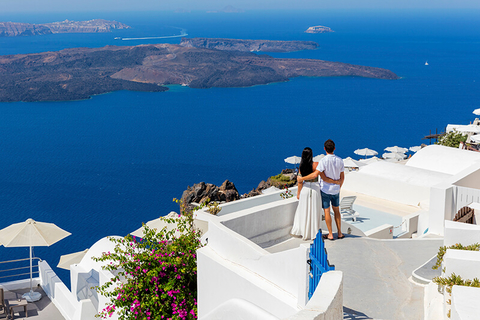 couple in Greece overlooking ocean