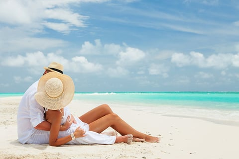 A couple lounging on the beach