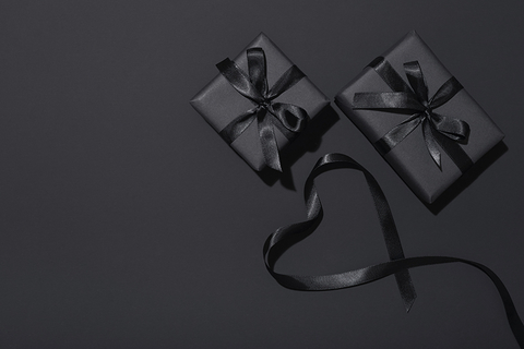 two gifts wrapped in black