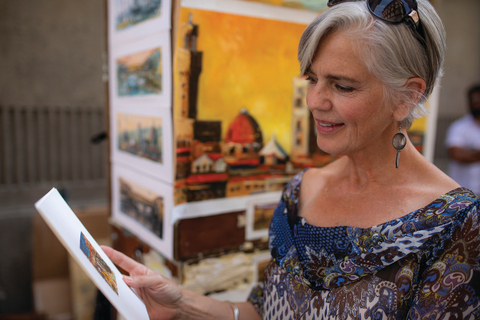 Image of woman holding artwork