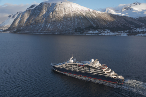Image of the new ship cruising near a mountain