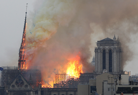 Flames rise from Notre Dame cathedral as it burns in Paris.