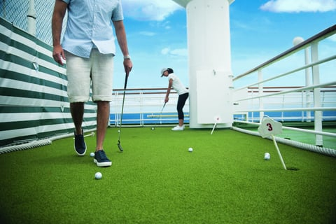 Image of individuals on a cruise putting green