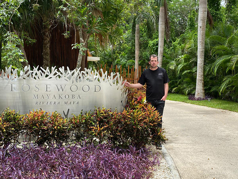 Dylan Clements at the entrance of Rosewood Mayakoba