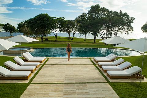 woman at a villa pool