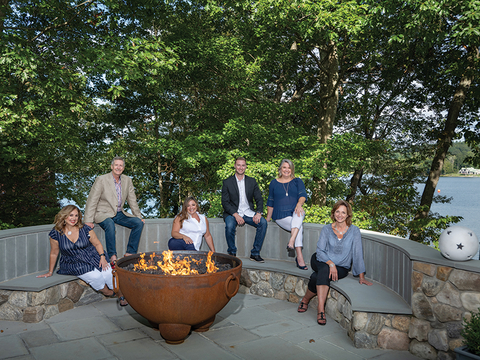 Lori Bartlett, Paul Largay, Melissa Russo, Scott Largay, Amanda Klimak and Vira Mastroianni pose at Paul Largay's home on Lake Quassapaug, Middlebury, CT