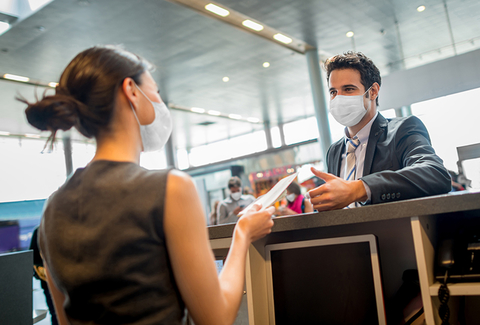 people in masks at airport gate