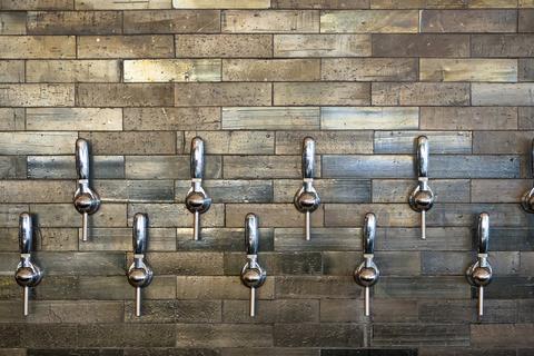 Silver taps on modern bar wall