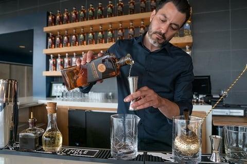 Bartender making drinks with Rabbit Hole whiskey at OverLook cocktail bar inside Rabbit Hole Distillery