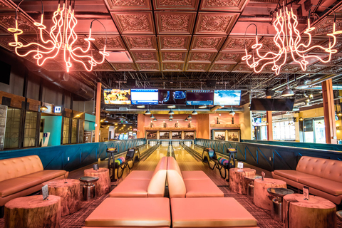 Bowling lanes and seating inside Punch Bowl Social in Rancho Cucamonga