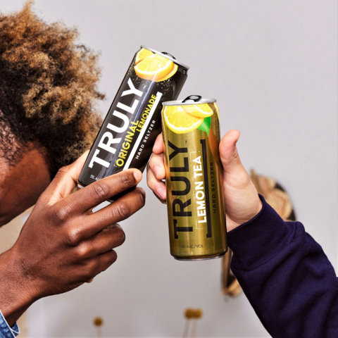 Two friend's toast with their Truly hard seltzer's (Photo: Courtesy of Boston Beer Company)