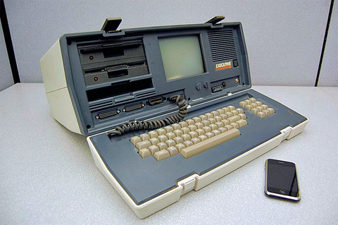 Fig. 1: the Osbourne Executive office computer produced in the early 1980s next to an Apple® iPhone® device. The phone has around 500 times the computing capability of the old computer, and its memory is 16,000 times larger. (Image credit: Casey Fleser un