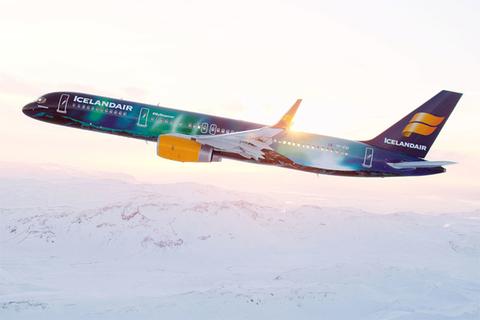 Icelandair airplane flying over snow
