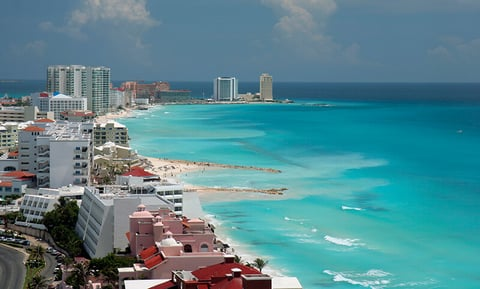 A view of the beach and hotels in Cancun