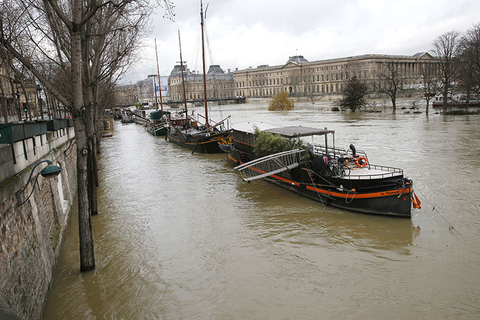 Boats are lined up along the flooded river Seine in Paris France