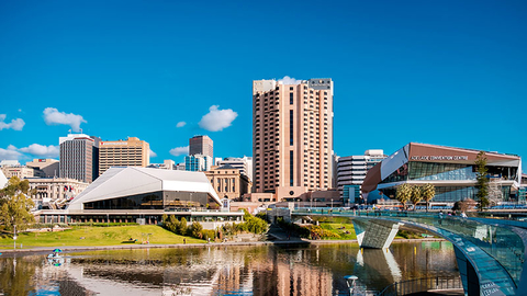 Adelaide city skyline viewed across Elder Park on a bright day