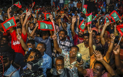 Maldivian opposition protestors shout slogans demanding the release of political prisoners during a protest in Male, Maldives.