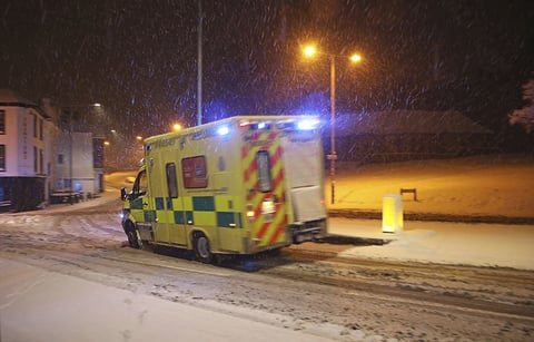 An ambulance drives through the snow in Tunbridge Wells, southern England, following heavy overnight snowfall which has caused disruption across Britain.