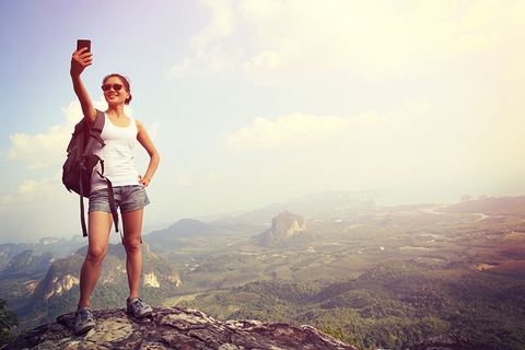female hiker taking a selfie